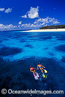 Snorkelers in island lagoon Photo - Gary Bell