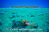 Snorkellers on coral reef Photo - Gary Bell