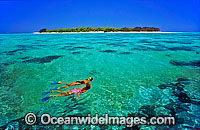 Snorkelers island lagoon photo